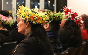 Women wearing head ei at a Cook Islands Constitution day reception in Wellington.