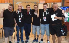 The New Zealand men's bridge team, 'Bridge Blacks' shortly after learning they are through to the semi-finals.