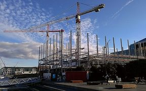 Construction with cranes against a blue sky
