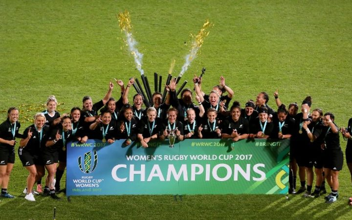 New Zealand's captain Fiao'o Faamausili holds the cup as players celebrate the fifth Black Ferns' world title.