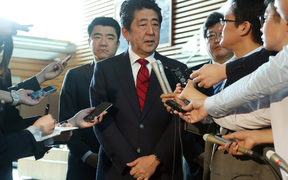 Japan's Prime Minister Shinzo Abe (centre) speaks to reporters at his official residence in Tokyo after the latest test.