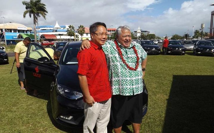 Chinese Ambassador in Samoa Wang Xuefeng and PM Tuila'epa Sa'ilele Malielegaoi at the presentation of 20 brand new Sedan vehicles for the Pacific Island Forum meeting to be hedl in Samoa next week.