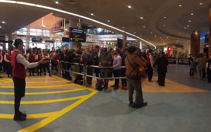 The crowd waits for the Black Ferns to arrive at Auckland Airport.