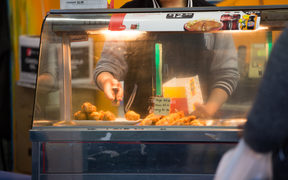 Fried chicken being served up at a takeaway in Mangere Town Centre