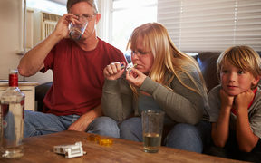 A family with mother taking drugs and father drinking.