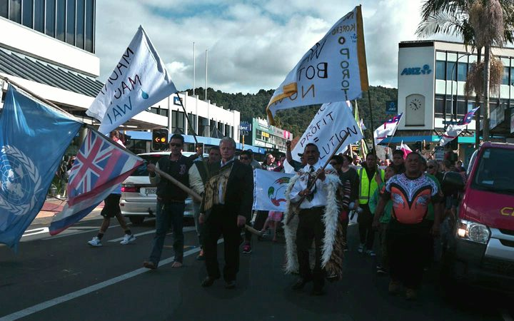 Protestors march through Whangarei to voice their disagreement with plans to allow Zodiac Holdings to build a water bottling factory at Porotī Springs.