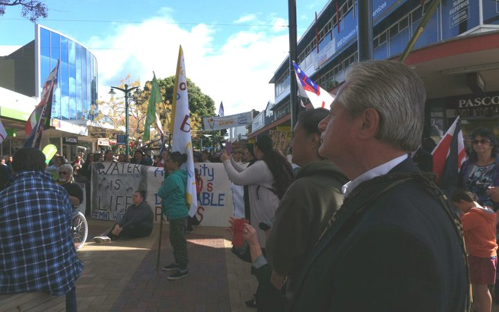 Protestors gather outside the Northland Regional Council. March organiser Millan Ruka is in the right foreground.