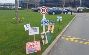 Protest signs outside IAG's Christchurch office.