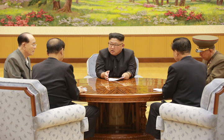 North Korean leader Kim Jong-un, centre, meeting members of the Workers' Party of Korea. Image released by  official Korean Central News Agency (KCNA) on 4 September.