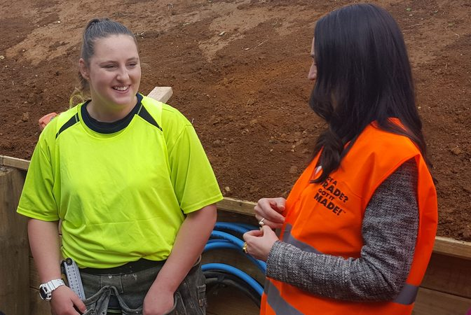 Labour Party leader Jacinda Ardern, right speaking to the sole female apprentice on a Pukekohe building site, 18-year-old Megan Youth-Cathcart, .