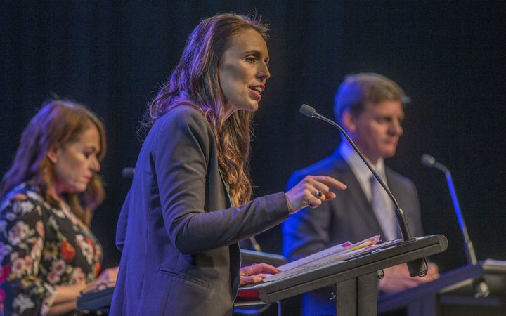 Jacinda Ardern, centre, and Bill English, right, in the third leaders debate.