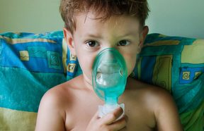A child with asthma using a nebuliser inhaler for breathing problems (file photo).