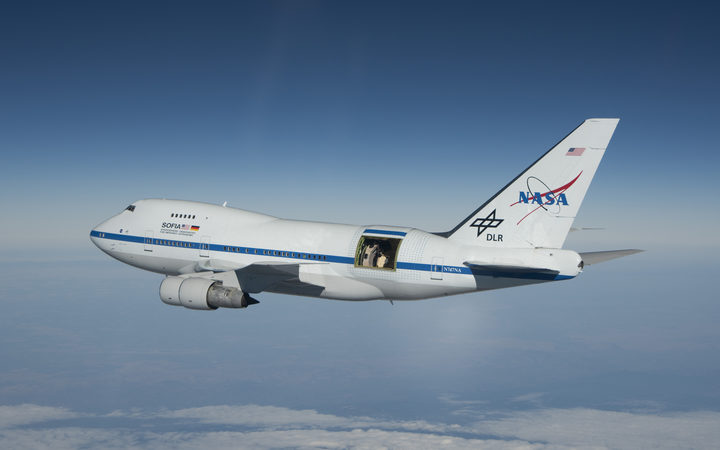 SOFIA in flight with the telescope door open.