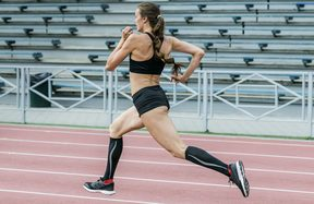 female track runner in compression tights