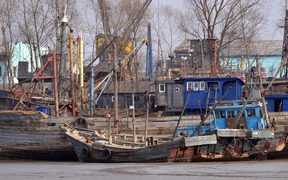 North Korean fishing vessels are docked on the banks of the Yalu River in the North Korean border town of Sinuiju on April 6, 2009 across the river from Dandong, in northeast China's Liaoning province.