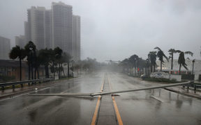 East Oakland Park Boulevard is completely blocked by a downed street light pole as Hurricane Irma hits the southern part of the state near Fort Lauderdale.