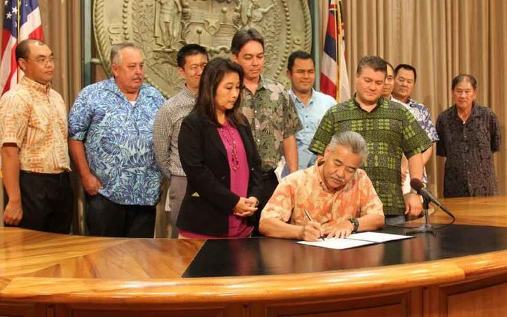 Hawaii Governor David Ige signs the bill into law on how to fund a Honolulu rail shortfall to complete construction.