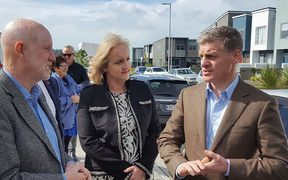 Bill English (right) at the Hobsonville housing development with Social Housing minister Amy Adams (centre) and real estate salesperson Mike Pearce (left).