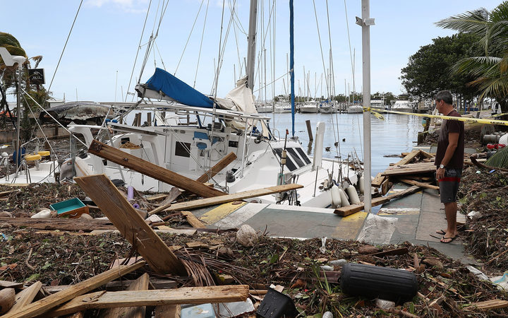 A damaged boat is seen at the Dinner Key marina after Hurricane Irma passed through the area on September 11, 2017 in Miami, Florida.