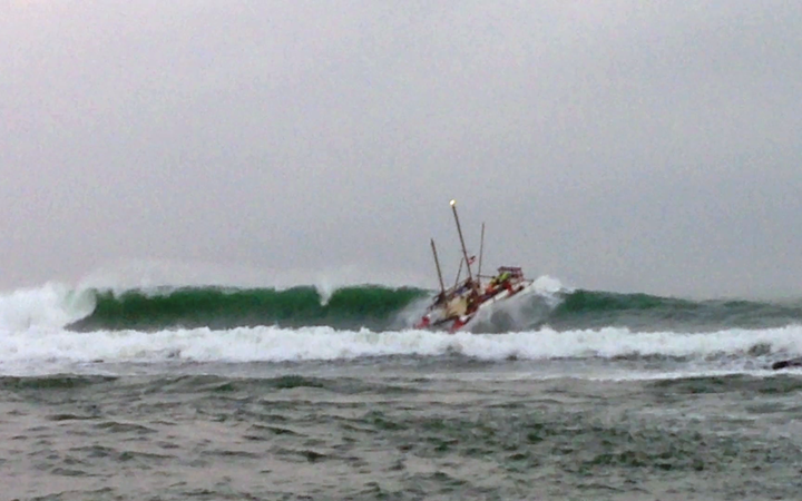 The 2m swell capsized the waka, tossing six men overboard.