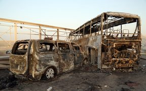 A general view show burnt out vehicles after gunmen and suicide car bombers killed dozens of people in two assaults claimed by Islamic State (IS) group jihadists near the southern Iraqi city of Nasiriyah on September 14, 2017.