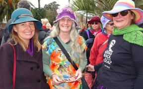 Kate Fulton, Debs Martin and Lulu Purda getting ready to walk in the Suffrage Day march in Nelson today.