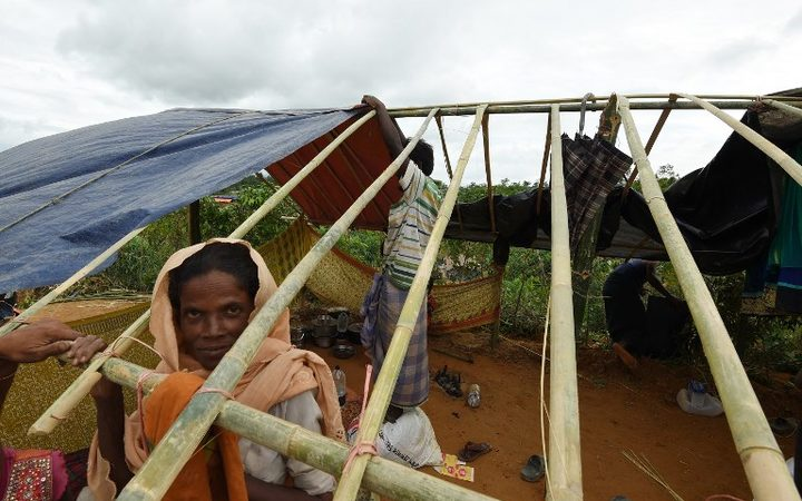 Rohingya refugees build a new makeshift shelters in the refugee camp of Thyangkhali near the Bangladeshi village of Gumdhum, on September 18, 2017. More than 400,000 Rohingya Muslims have now arrived in Bangladesh from their Buddhist do