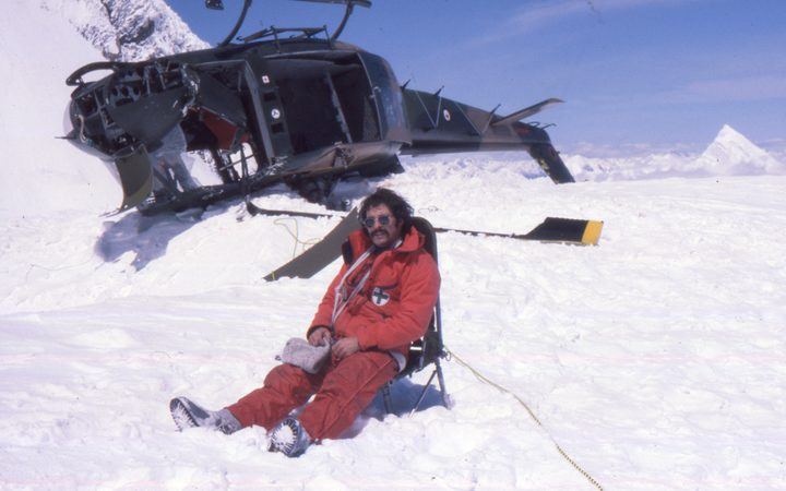 A photo of Don Bogie with the crashed Iroquois helicopter at the Upper Empress Shelf on Mt Cook