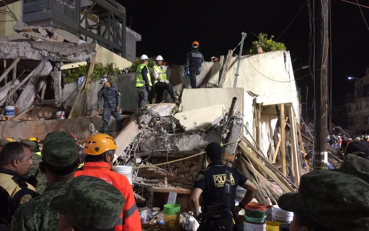 Rescue teams search Rébsamen school in Mexico City overnight for people still missing.