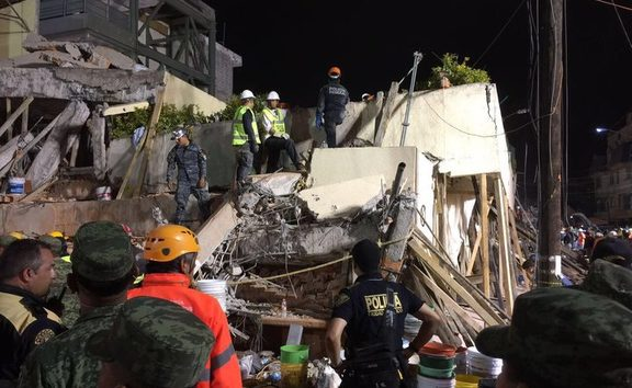 Rescue teams search overnight for survivors at Enrique Rébsamen primary school in Mexico City.