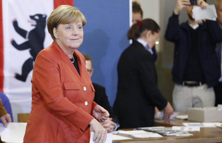 Merkel wins German election, but anti-migrant party steals headlines