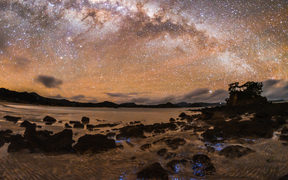 Milky Way with sea and beach in the foreground