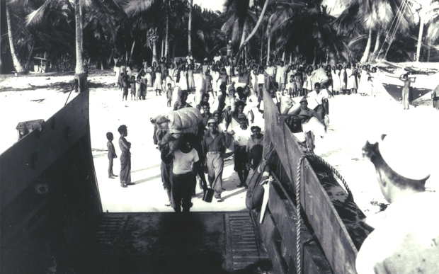 Bikinians in the Marshall Islands being evacuated from their home island after nuclear testing in the area by the US.
