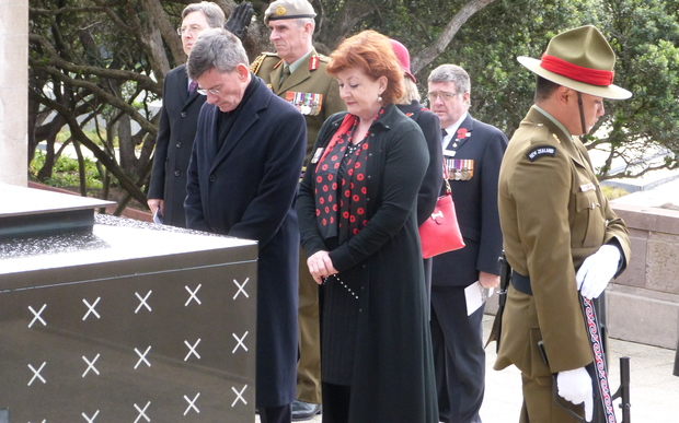Minister Maggie Barry and Attorney-General Chris Finlayson pay their respects at the tomb of the unknown warrior.