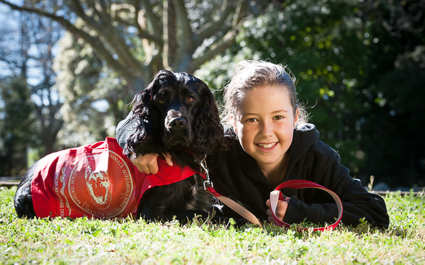 Esther and her medical response dog, Molly.