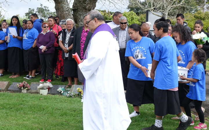 Members of a Mangere youth group carry Mona's coffin.