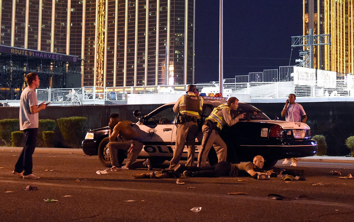 Las Vegas police stand guard along the streets outside the festival grounds of the Route 91 Harvest on October 1, 2017 in Las Vegas, Nevada.