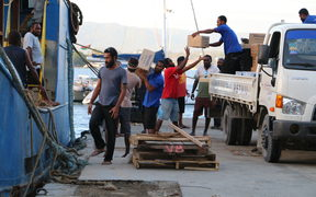 Donated goods being loaded onto a ship in Port Vila preparing to sail for Ambae.
