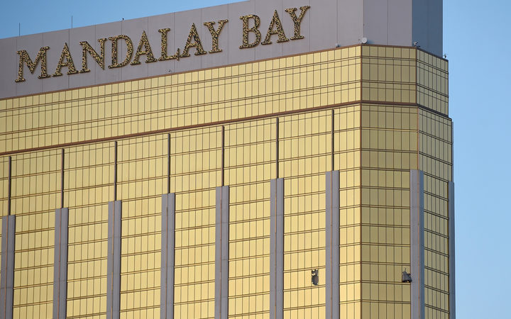 Broken windows on the 32nd floor of the Mandalay Bay Resort and Casino.