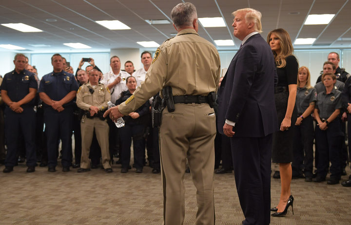 Donald Trump and Melania Trump meet with police and first responders in Las Vegas following the attack.