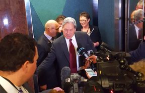 Mr Peters giving a press conference in an elevator.