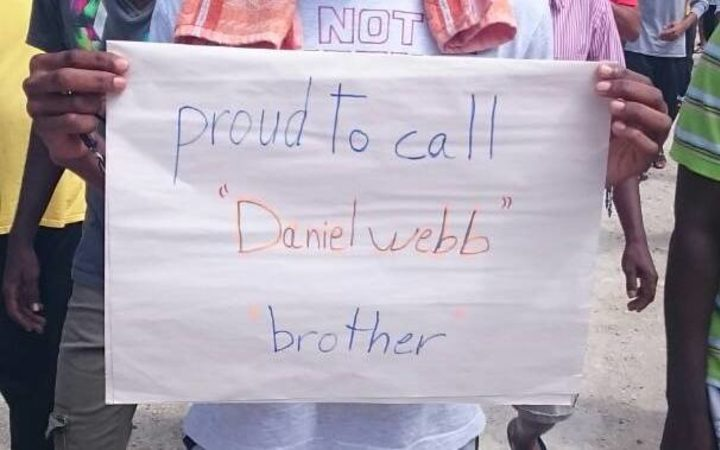 A Manus detainee holds a sign marking Mr Webb's award.