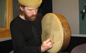 Chris O'Connor playing a bodhran