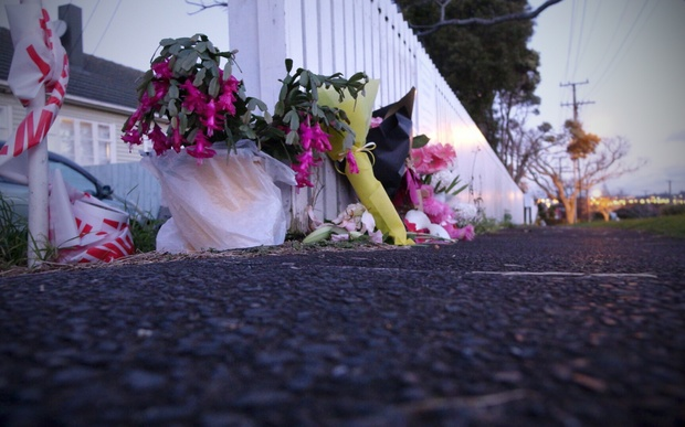 Police cordons and flowers on Tuesday at the house in Onehunga where Maggie Renee Watson was found.