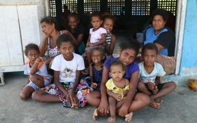 Wendy Karo( far right back row) says mothers in the evacuation centres worry for their children's education.