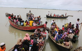 Rohingya people, fled from ongoing military operation in Myanmar Rakhain state, ride on boat at Shah Pori Island to go to refugee camp in Shah Pori Island in Bangladesh on October 07, 2017.
