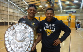 Seta Tamanivalu and Waisake Naholo holding the Ranfurly Shield at training at the TSB Stadium.