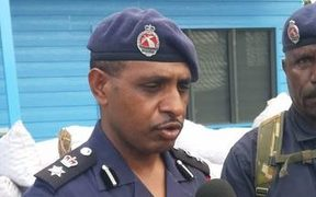 Arrested former police chief of Port Moresby Andy Bawa. (Left)