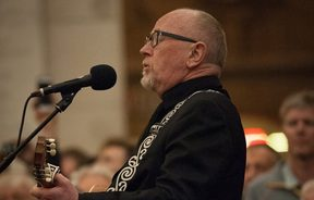 Dave Dobbyn performs at the Last Post Ceremony at the Menin Gate in Ieper, Belgium