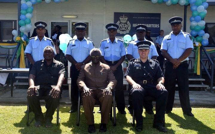 The five new RSIPF Officers  (standing) being deployed on the UN Peacekeeping Mission to Sudan with the Prime Minister, Hon. Manasseh Sogavare (sitting centre), Minister of Police, National Security and Correctional Services, Hon. Moses Garu (sitting left) and the Commissioner, Matthew Varley.